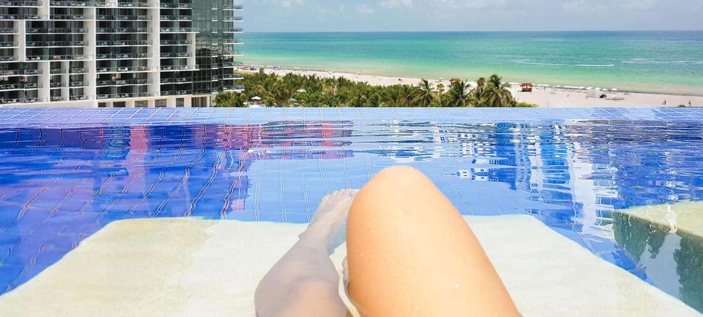 woman in pool on rooftop in miami